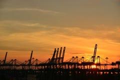 Coucher du soleil au port Image libre de droits