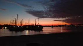 Coucher du soleil au port ! Image libre de droits