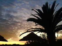 Coucher du soleil au regroupement Image stock