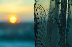 Coucher du soleil avec des rideaux Photographie stock libre de droits