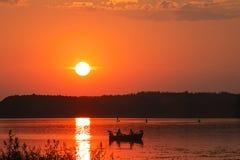 Coucher du soleil bateau Photos libres de droits
