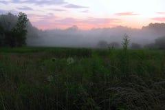 Coucher du soleil brumeux Photographie stock libre de droits