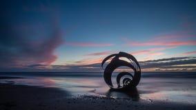 Coucher du soleil chez Marys Shell sur la plage de Cleveleys photographie stock libre de droits