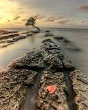 Coucher du soleil chez Pantai Kuri Caddi Images stock