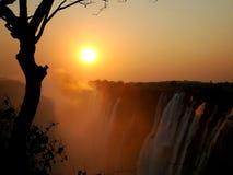 Coucher du soleil chez Victoria Falls Images stock