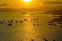 Coucher du soleil chez Victoria Harbor HK Photographie stock