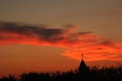 Coucher du soleil d'église Photographie stock libre de droits