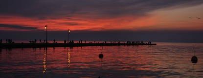 Coucher du soleil d'audace de molo de Trieste Photos stock