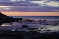 Coucher du soleil dans la baie Image libre de droits