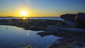 Coucher du soleil dans la baie de botanique photo stock