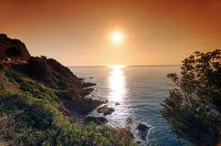 Coucher du soleil dans la côte d'île de Corse Photos stock