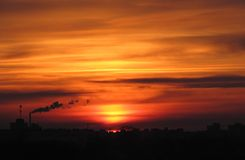 Coucher du soleil dans la ville Photographie stock