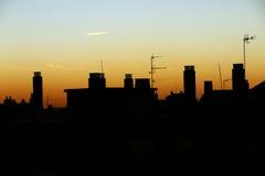 Coucher du soleil dans la ville Photos stock