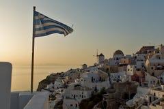 Coucher du soleil dans la ville d'Oia, Santorini, Tira Island, Cyclades Images stock