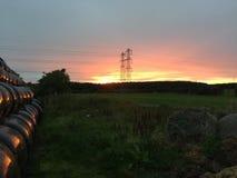 Coucher du soleil dans le Northumberland images libres de droits