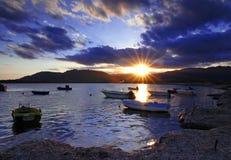 Coucher du soleil dans le port Photographie stock libre de droits