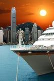 Coucher du soleil dans le port de Hong Kong Photographie stock libre de droits