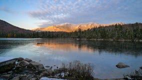 Coucher du soleil dans les montagnes blanches Photos stock