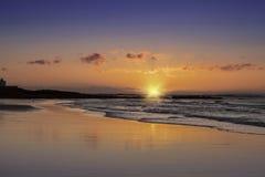 Coucher du soleil de Bamburgh Photographie stock libre de droits