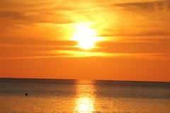Coucher du soleil de caïman Images stock