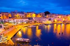 Coucher du soleil de Calasfonts Cales Fonts Port dans Mahon chez Balearics Photographie stock libre de droits