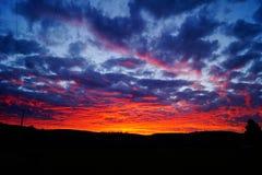 Coucher du soleil de champ Photographie stock libre de droits