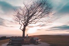 Coucher du soleil de colline de Cleeve Photo stock