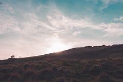 Coucher du soleil de colline de Cleeve Images stock