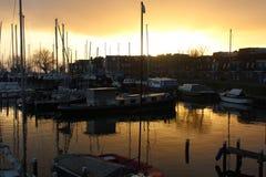 Coucher du soleil de docks Photographie stock