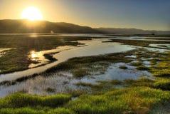 Coucher du soleil de fleuve Images stock