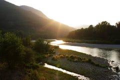coucher du soleil de fleuve Image libre de droits