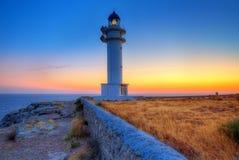 Coucher du soleil de Formentera dans le phare de cap de Barbaria Photo libre de droits