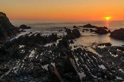 Coucher du soleil de Hartland Quay images stock