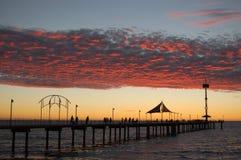 Coucher du soleil de jetée de Brighton photographie stock libre de droits