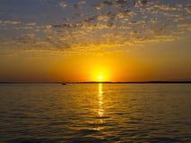 Coucher du soleil de l'eau Photographie stock