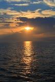 Coucher du soleil de la mer Photographie stock