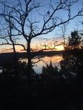 Coucher du soleil de lac rock de Tableau Images stock