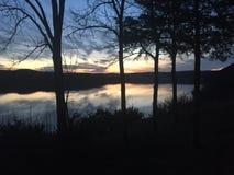 Coucher du soleil de lac rock de Tableau Photos stock
