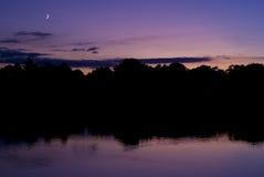 Coucher du soleil de lever de la lune Photo libre de droits