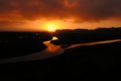Coucher du soleil de marais Photos stock