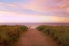 Coucher du soleil de mer de chemin Photographie stock