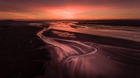 Coucher du soleil de mudflats de Loughor images libres de droits