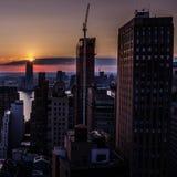 Coucher du soleil de New York City Photographie stock libre de droits