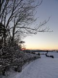Coucher du soleil de paysage de neige Photo stock