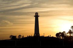 Coucher du soleil de phare Photos stock