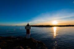 Coucher du soleil de phare photographie stock