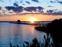 Coucher du soleil de pilier de pêche Photo stock