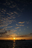 coucher du soleil de pilier de pêche Image libre de droits