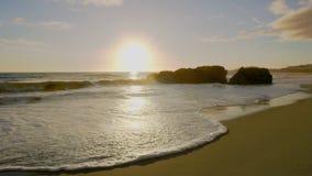 Coucher du soleil de plage d'Albufeira photographie stock libre de droits