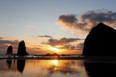 Coucher du soleil de plage de canon photos stock